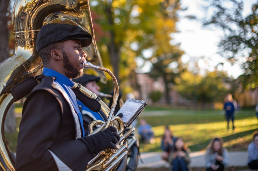 A student in UNH's Homecoming Parade