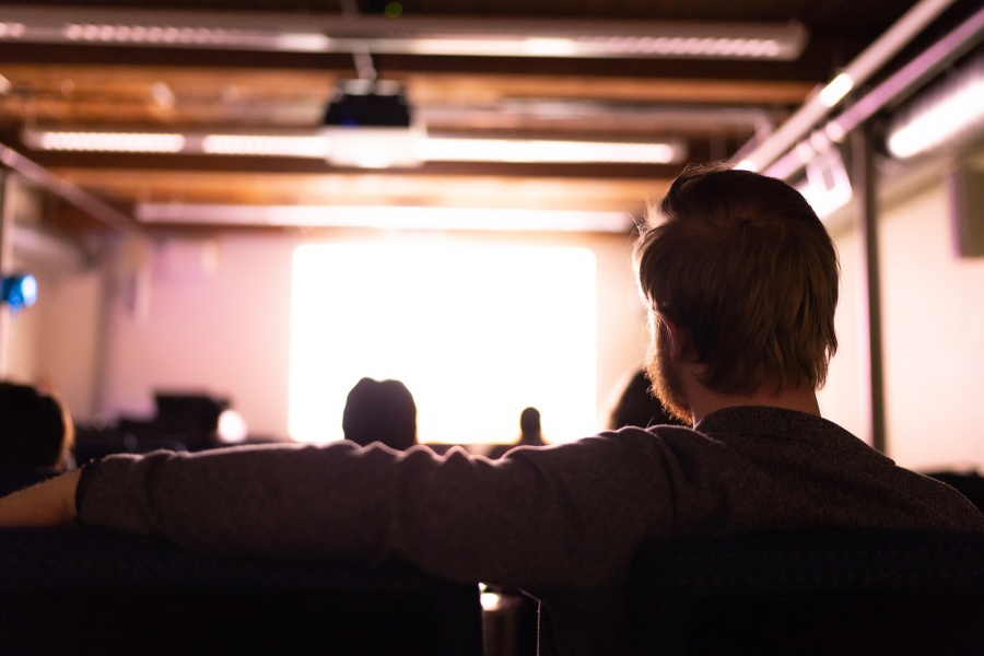 People in a movie theatre at UNH Manchester watching the films of students who are studying cinema arts