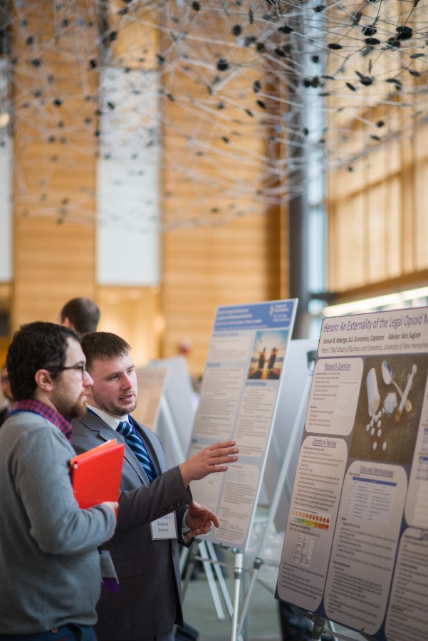 A University of New Hampshire student presenting research results during the 2018 Paul College of Business and Economics Undergraduate Research Conference