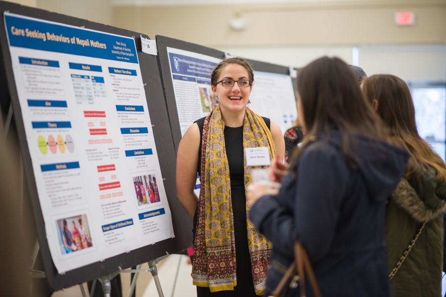 A UNH student presenting the results of her research during the UNH College of Life Sciences and Agriculture Undergraduate Research Conference 2018