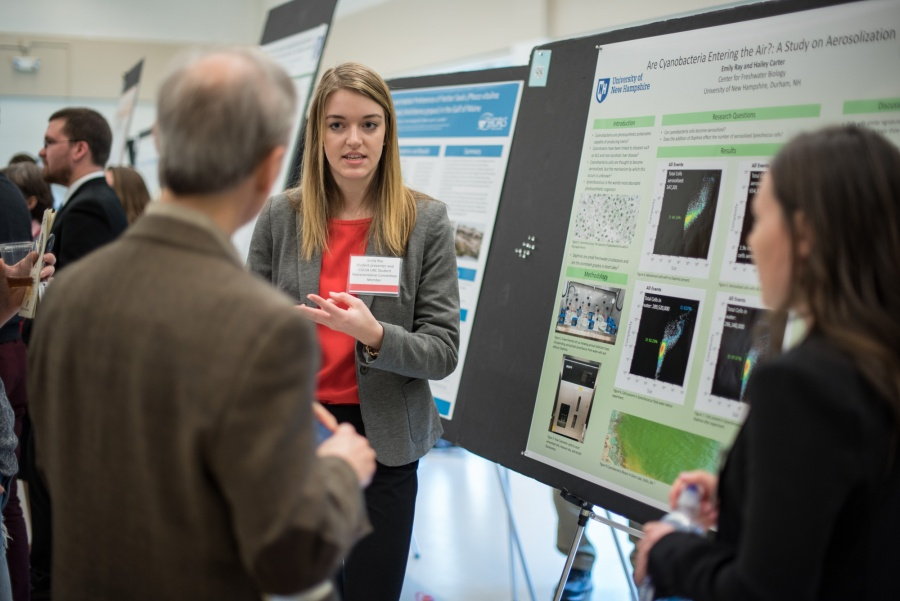 A student from the UNH College of Life Sciences and Agriculture presents her research poster during the 2018 Undergraduate Research Conference