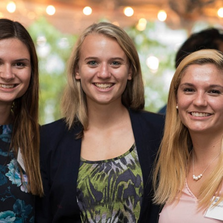 UNH alumni and students at the Paul College homecoming reception