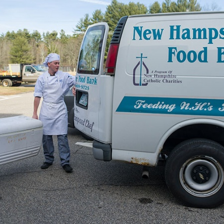 Brad LaMonica and Ciara McCarter from UNH's Thompson School of Applied Science Culinary Arts & Nutrition program load tilapia onto N.H. Food Bank truck