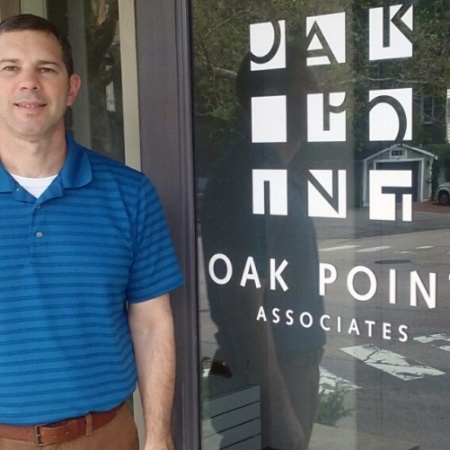 UNH graduate Robert Bender '17 in front of Oak Point Associates