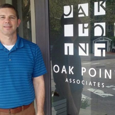UNH graduate Robert Bender '17 in front of Oak Point Associates