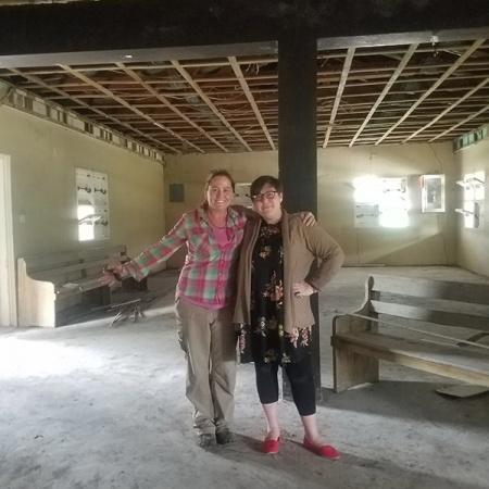 2 women standing in empty museum space