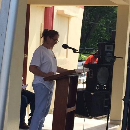 photo of woman at podium