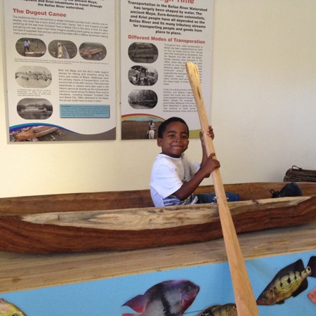 boy in dug-out canoe