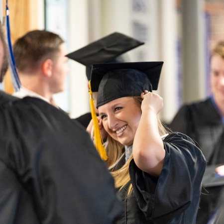 UNH Manchester graduates congratulating one another