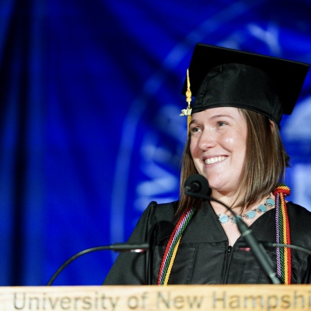A student speaker at the lectern at UNH Manchester Commencement 2018