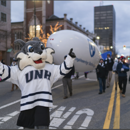 UNH mascot Wild E. Cat at the Manchester, NH, holiday parade 2016