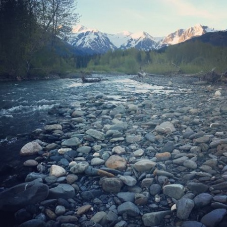 view of Alaskan stream with smooth pebble rocks