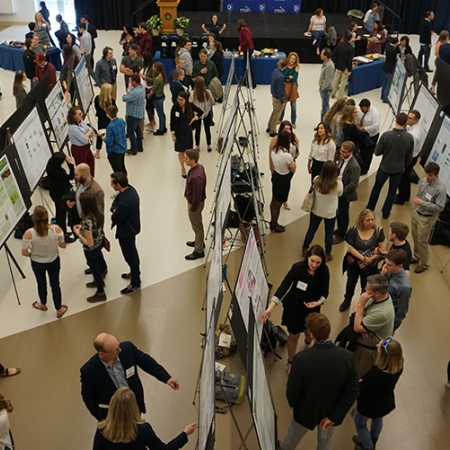 Aerial view of presenters at COLSA's URC poster presentation.
