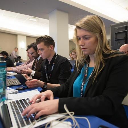 UNH journalists in filing room during Democratic presidential debate