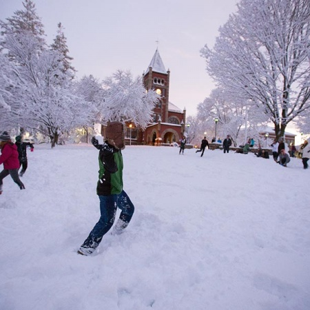 Snowball fight on Thompson Hall lawn at UNH