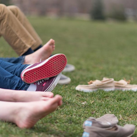 Bare feet on Thompson Hall lawn at UNH