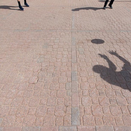 shadow of a person playing ball