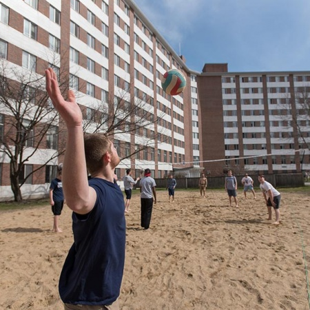 Volleyball game behind Stoke Hall at UNH