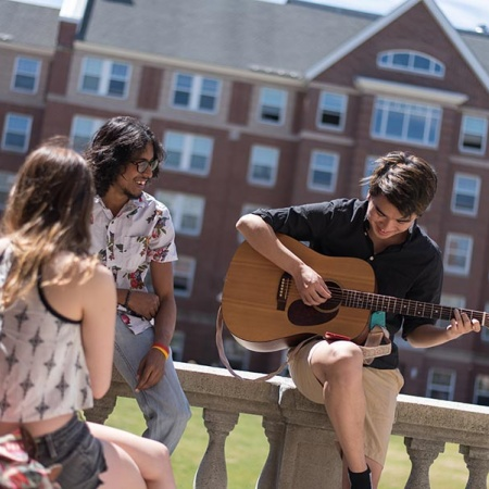 students playing guitar at UNH