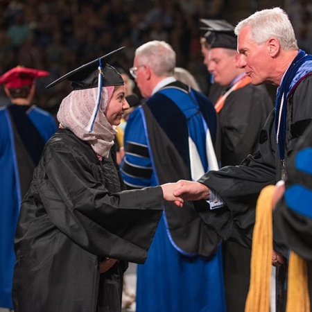 Yussra Ebrahim and UNH President Mark W. Huddleston