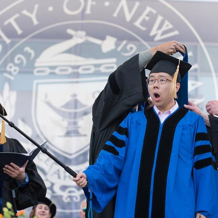 UNH doctoral candidate with selfie stick