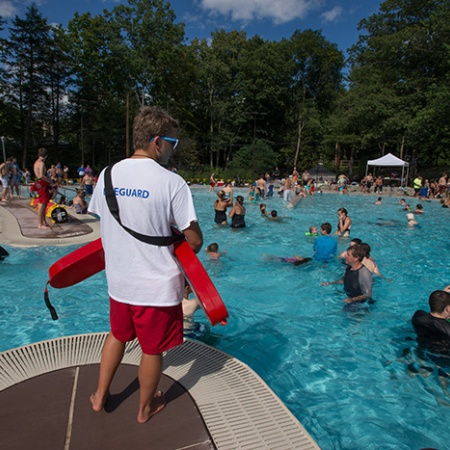 a lifeguard at UNH's new outdoor pool opening