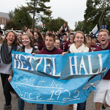 A group of Hetzel Hall residents with banner