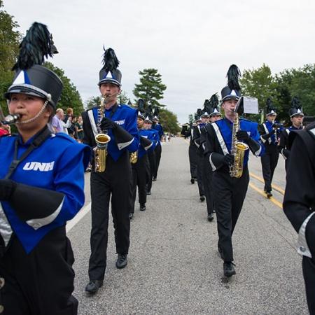 UNH marching band playing at the Homecoming parade