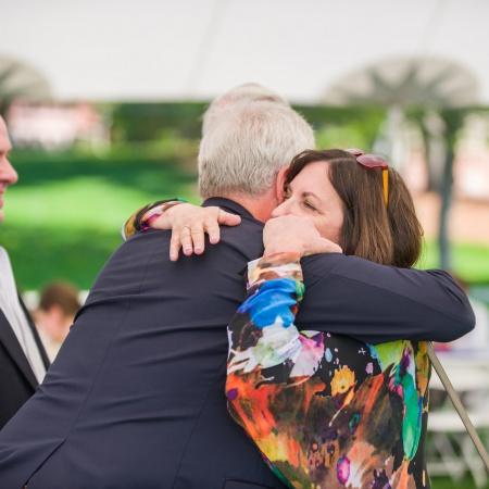 UNH outgoing president Mark Huddleston gets a hug