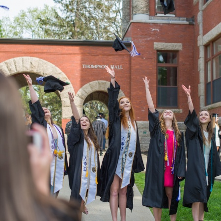 UNH seniors pose for pre-graduation pictures on campus during the week before commencement