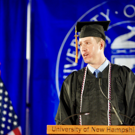 A UNH Manchester student speaks at Commencement