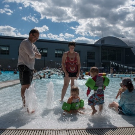 family at the opening of UNH's new outdoor pool