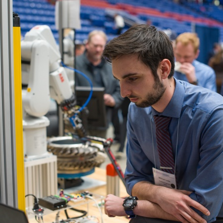 A University of New Hampshire student presenting research results during the 2018 Interdisciplinary Science and Engineering Symposium, part of the annual UNH Undergraduate Research Conference