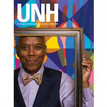 UNH Magazine Winter 2019 Cover - Richard Haynes holding a picture frame