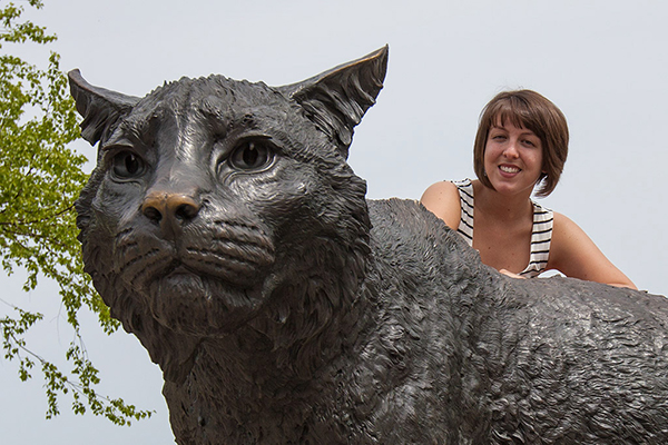 Abby Lamothe at Wildcat statue