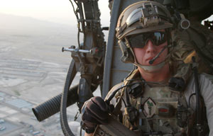 Kandahar, Afghanistan: Captain Eric as the helicopter passes over the outskirts of Kandahar City, Afghanistan.(NGT)