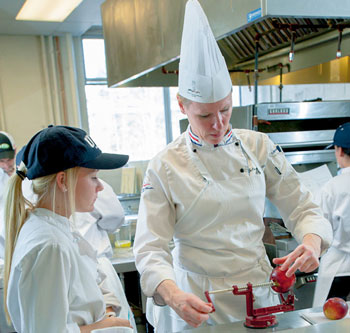 Dietetic technology student, Audra St. Hilaire from Merrimac, Mass., attends closely as Chef Julienne Guyette instructs.