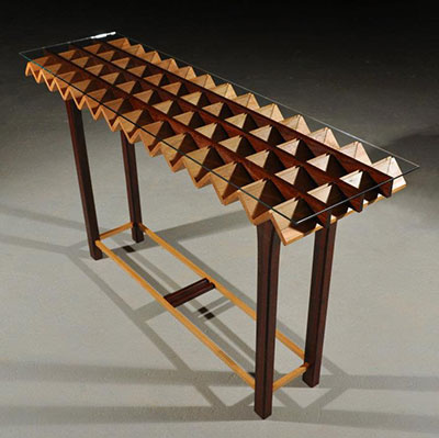 Accordion table, padauk, beech, and glass, 2010. Photo by Dustin Marshall, www.beaudoinwood.com
