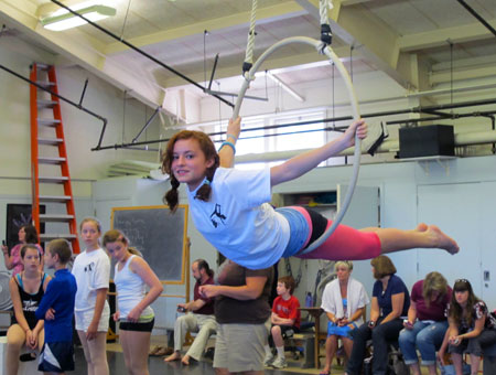 A young camper practices on the lyra during the aerial summer camp offered through the theater and dance department.