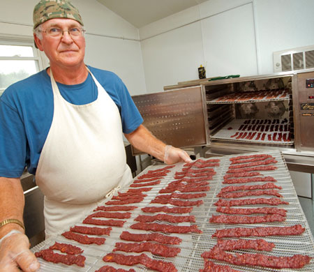 Bert von Dohrmann removes a tray of beef jerky