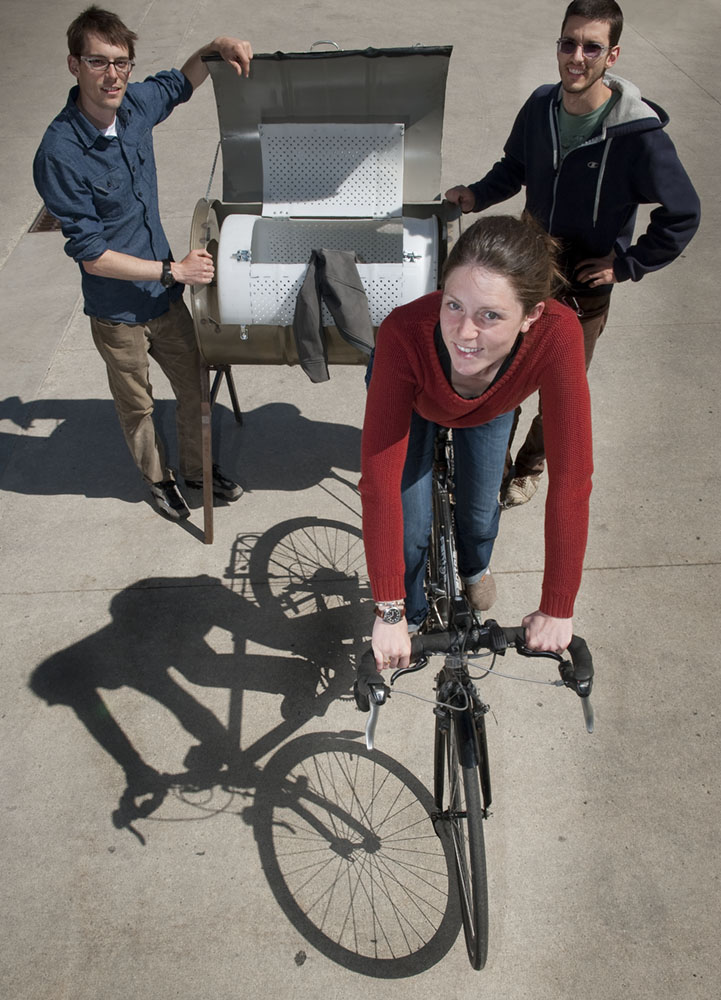 For their senior project, Vincent Lyon, (from left), Britta Moore, and Garrett Cassidy fabricated a bicycled-powered washing machine that can clean a load of clothes in 30 minutes using only six gallons of water.