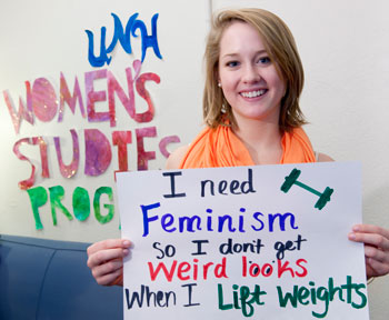 "Stephanie Cuhn shows-off her sign she created at the Women's Studies Program's ""Who Needs Feminism"" campaign"