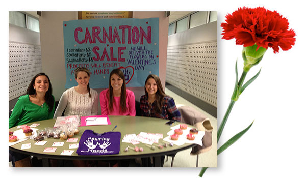 Aspiring Hands selling carnations