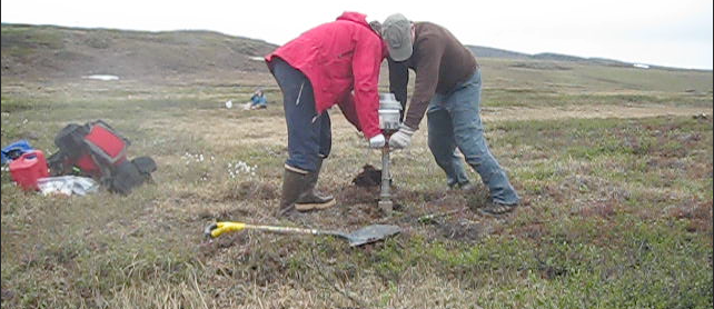 UNH PhD candidate Claire Treat drilling soil samples Alaska