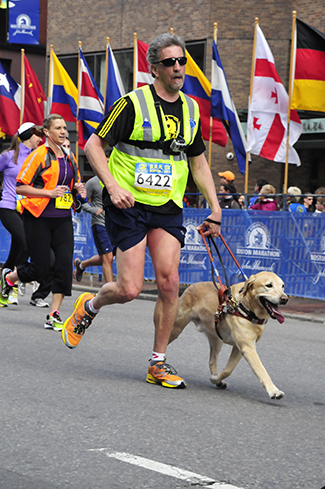 UNH alumnus Randy Quinn and his late guide dog Quinn finishing the B.A.A. 5K in 2013