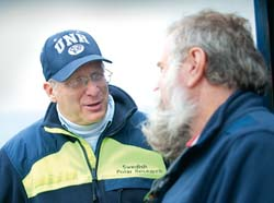 Larry Mayer, left, has a discussion with Dale Chayes, senior engineer from the Lamont Doherty Earth Observatory of Columbia University.