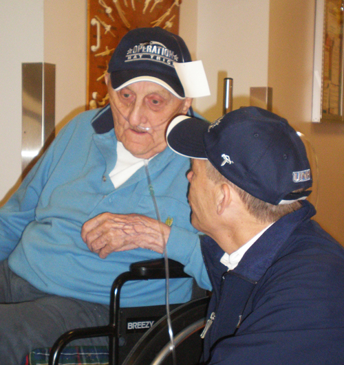 A veteran receives a hat from Operation Hat Trick