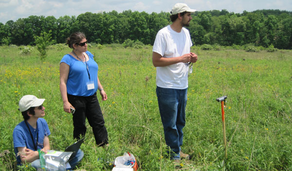 UNH graduate student Evangelos Korkolis, assistant professor of Earth science Margaret Boettcher, and graduate student Ian Honsberger look for a suitable site for a seismometer.