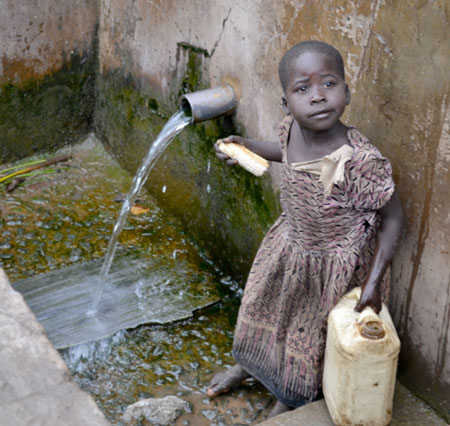 a child getting water in Uganda
