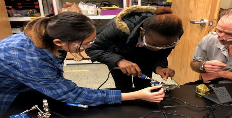 Two female students working on electronics at the STEM Discovery Lab